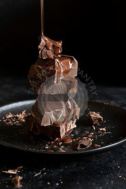 Stack of chocolate cubes on black background
