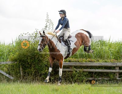 Jumping a hedge during the Belvoir Fun Ride 2020.