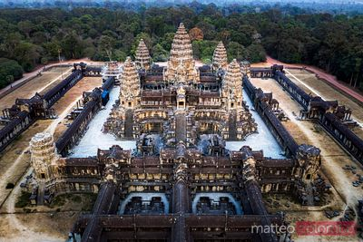 Aerial view of Angkor Wat temple complex at sunset, Cambodia