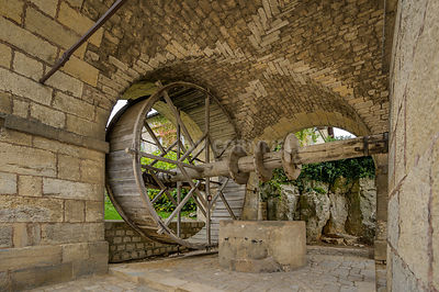 Large man powered wheel at the fountain within the Citadel of Besancon, fortifications of Vauban, UNESCO World Heritage Site,...