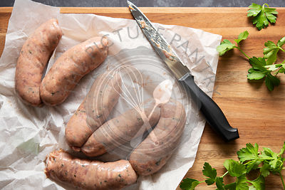 Raw beef sausages seasoned with fresh parsley.