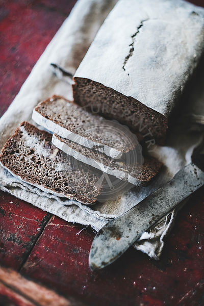Rye Swedish bread loaf cut in slices with vintage knife