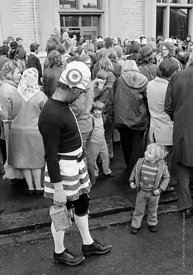 #77127,  The 'Nutters' Dance', Bacup, Lancashire,  1973.  On Easter Saturday every year the 'Coconut Dancers' gather at one b...