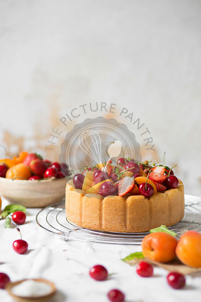 Cake with fresh summer fruit on the table