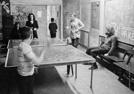 #75038  John Sugden, long hair and beard.  Table tennis, Liverpool Free School, Liverpool  1971.  Also known as the Scotland ...
