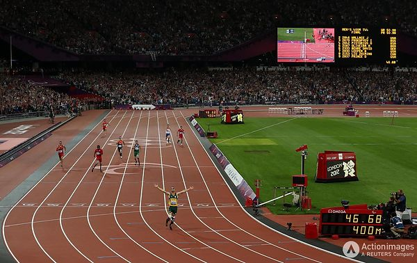 Paralympics - London 2012 Paralympic Games - Olympic Stadium - 8/9/12 Athletics - Men's 400m - T44 - Australia's Oscar Pistor...