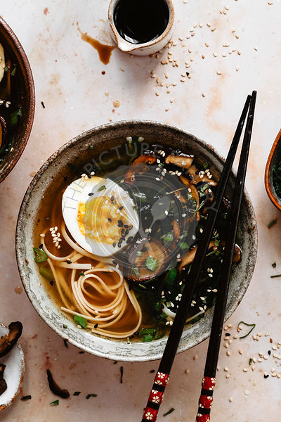 Close up of miso soup bowl with eggs