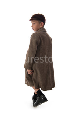A 1940's boy walking – shot from mid level.