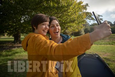 AN AUTHENTIC LGBTQ+STOCK PHOTO OF TWO LESBIANS OUTDOORS
