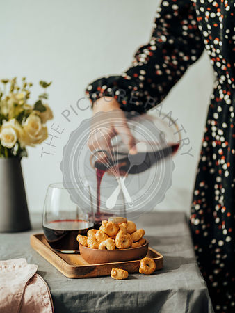 Taralli or tarallini and wine glass on the table