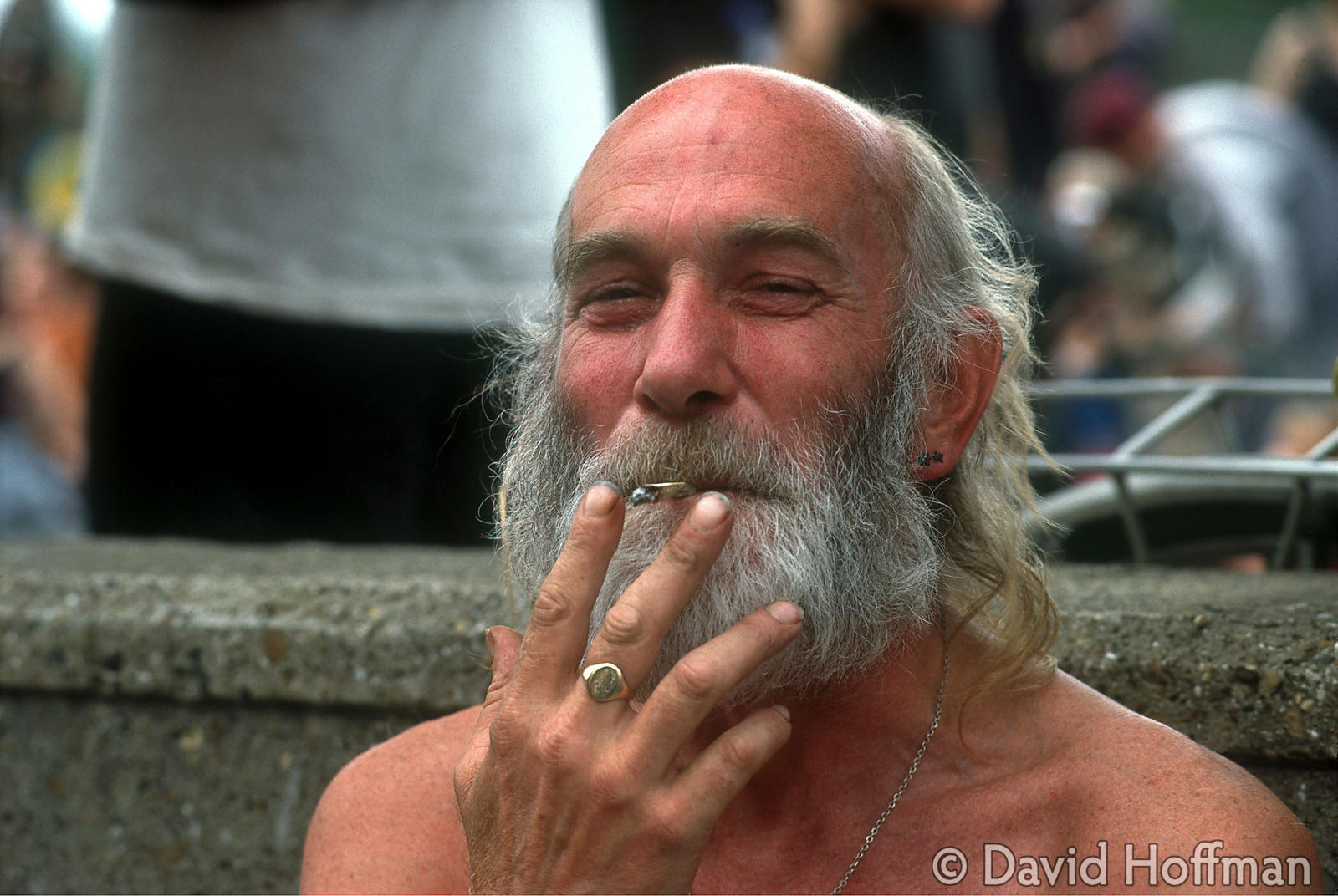 4.211/170 Happy man tokes on a joint during Reclaim the Streets, Shepherds Bush, 1996.