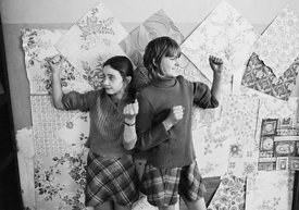 #75030  Decorating the walls with pages from a wallpaper catalogue, Liverpool Free School, Liverpool  1971.  Also known as th...