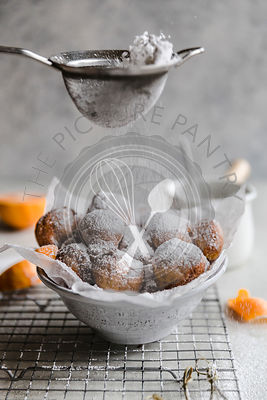 Cara cara fritters, with chocolate dipping sauce and powdered sugar