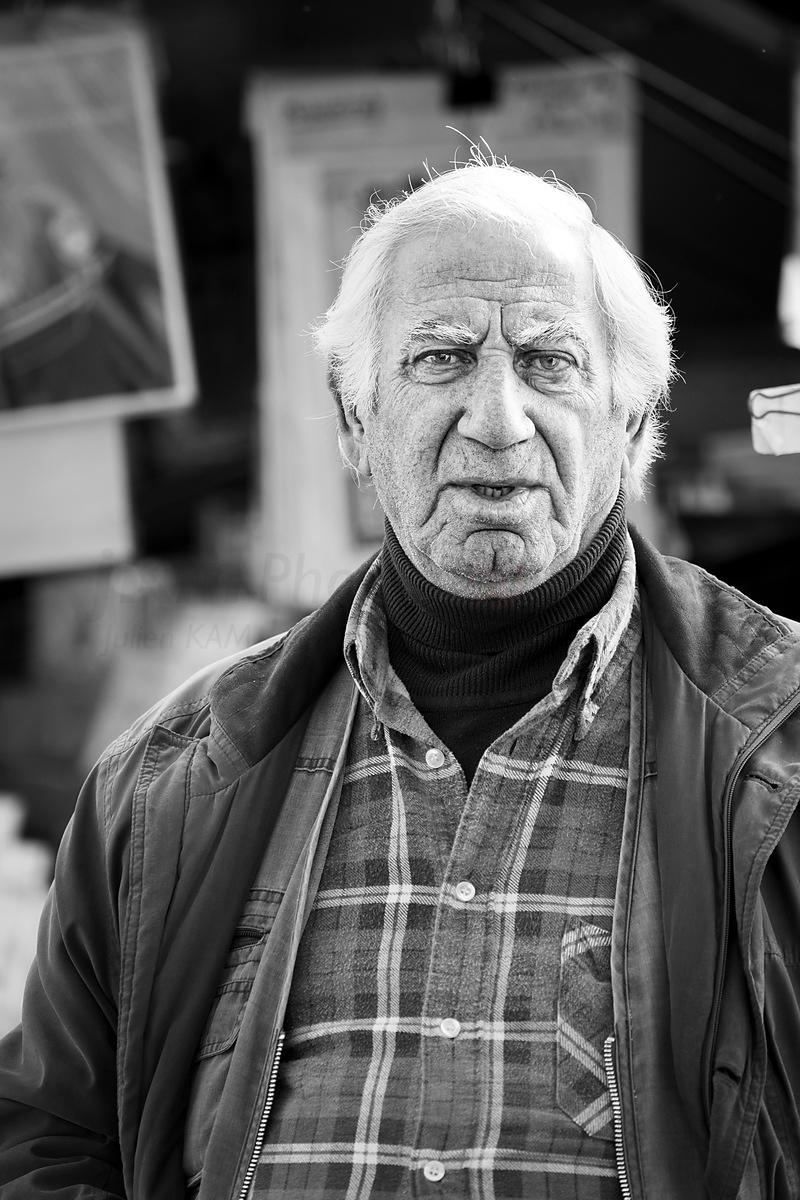 Street Photo - The old poster seller