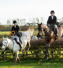 Christy Furness and Ben Hobday jumping a hedge. The Middleton Hunt at Bugthorpe 9/11