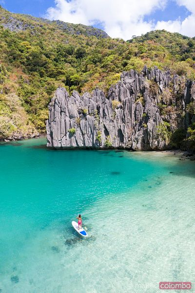 Aerial view of woman stand up paddling, Philippines