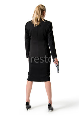 A woman standing with a gun – shot from mid level.