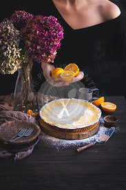 Homemade baked lemon tart on a rustic wooden table