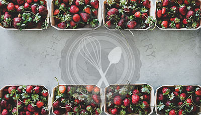 Fresh strawberries in plastic-free containers over concrete background, copy space