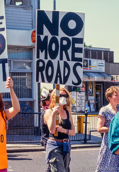 Women's enviromental network block road at Highbury Corner, London in protest at pollution caused by traffic.Summer 1994.