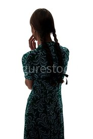 A silhouette of a 1940's girl in a dress – shot from eye-level.