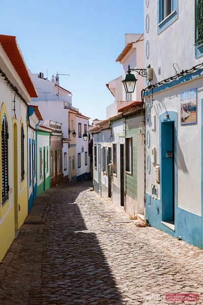 Colorful houses in narrow street, Ferragudo, Algarve, Portugal