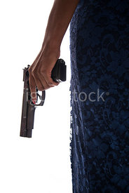 A woman in a long dress Holding a gun – shot from mid level.