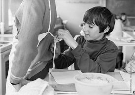 #83636,  Boys sorting out their aprons for cooking class, Whitworth Comprehensive School, Whitworth, Lancashire.  1970.  Shot...