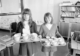 #83847,  Girls taking tea cups back from the staffroom, Whitworth Comprehensive School, Whitworth, Lancashire.  1970.  Shot f...
