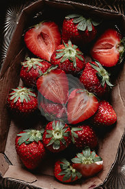 Strawberries into a paper container