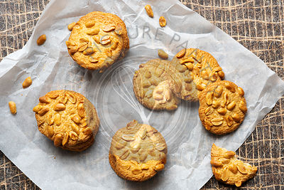 Three stacks of peanut cookies on baking paper.