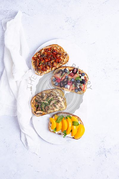cream cheese toasts with fruit and vegetables