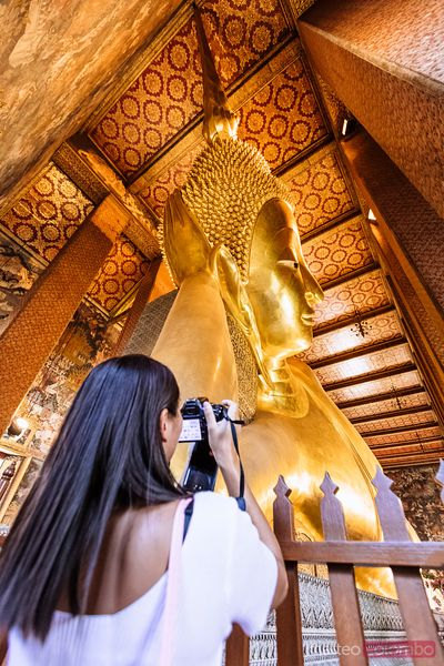 Tourist photographing the Reclining Buddha, Wat Pho, Bangkok