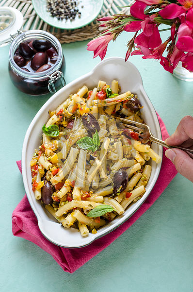 Pasta salad with vegetables and black olives