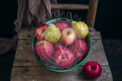 Apples and pears in a vintage bowl