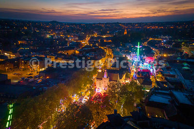 Aerial view of Banbury Town at sunset with the Micahelmas Fair in full swing