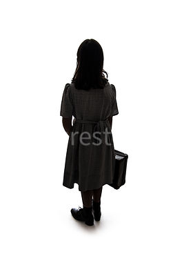 A silhouette of a 1940's child evacuee – shot from mid level.