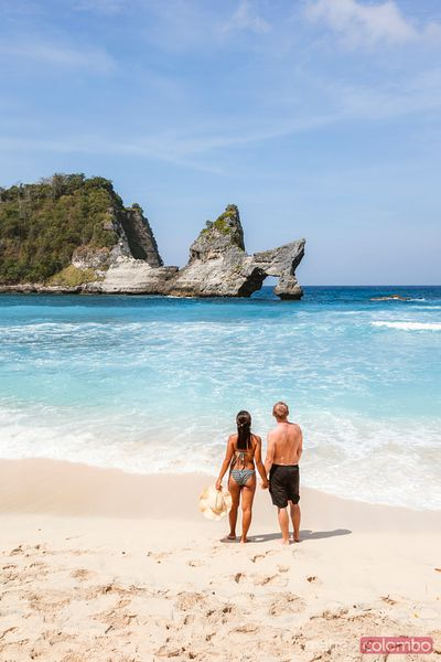 Tourist couple at Atuh beach, Nusa Penida, Bali