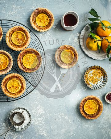 A flatlay of assorted Orange Saffron Frangipane Tarts