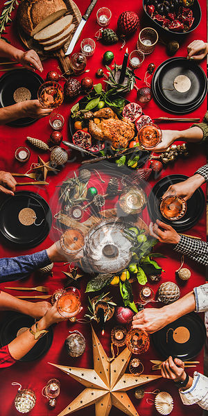 Flat-lay of family celebrating New Year at festive table