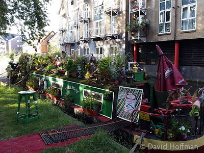 2015-06-25 19.07.35 Flowers cover a barge on the Regents Canal, Hackney, London.
