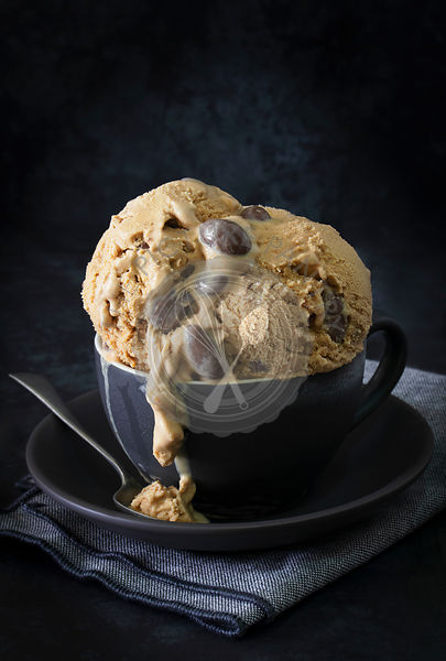 Coffee ice cream with roasted chocolate almonds in a cup.