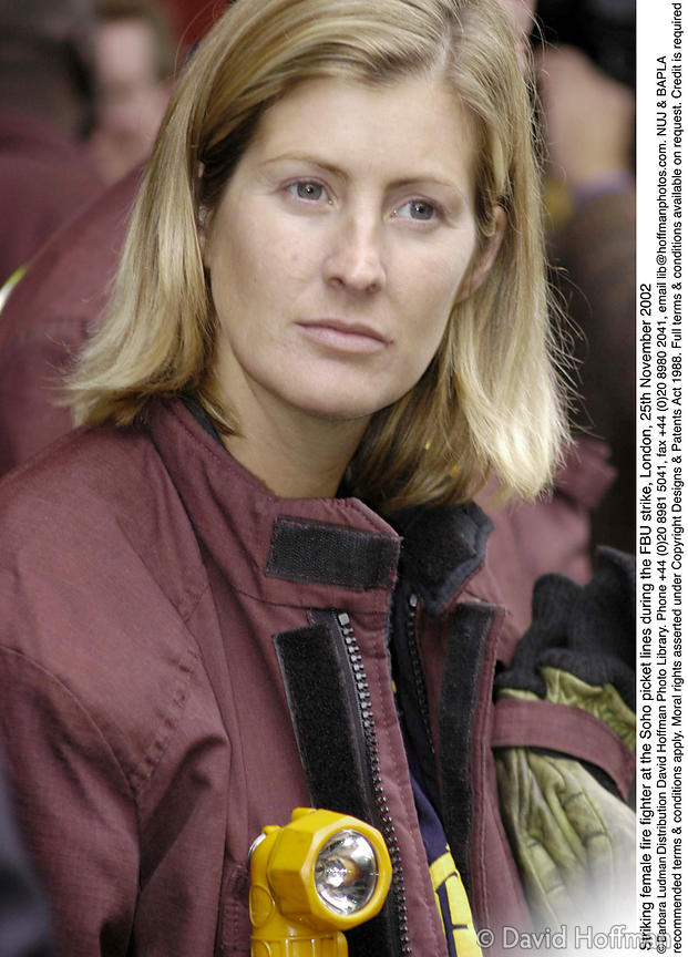 Striking female fire fighter at the Soho picket lines during the FBU strike, London, 25th November 2002 © Barbara Ludman. Dis...