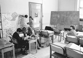 #75027  Decorating the walls with pages from a wallpaper catalogue, Liverpool Free School, Liverpool  1971.  Also known as th...