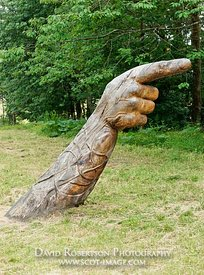 Image - Carved wooden sculpture of a hand at Ardfern