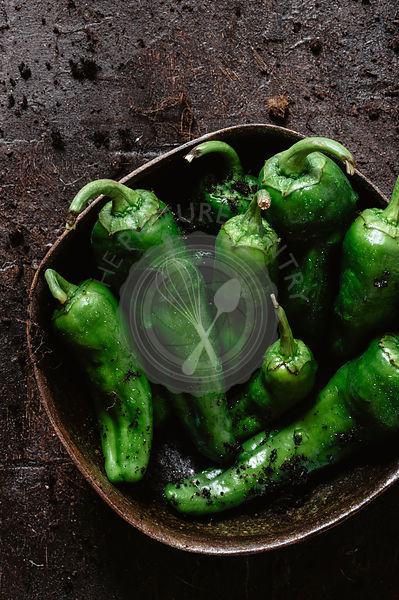 Green peppers into a bowl