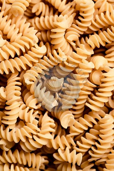 Macro shot of dried fusilli pasta.