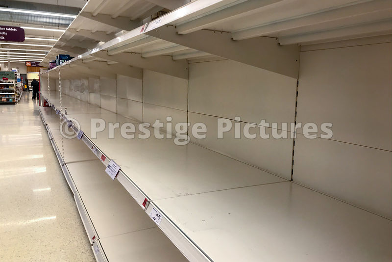 Empty toilet paper shelves in Sainsbury supermarket