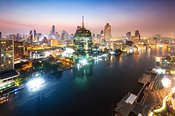 Chao Phraya river and skyline at dusk, Bangkok, Thailand
