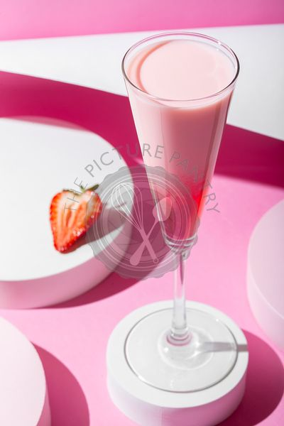 Pink cocktail on a pink background. Minimalistic set design